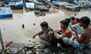 A resident makes tea in Surat during the floods of August 2006.