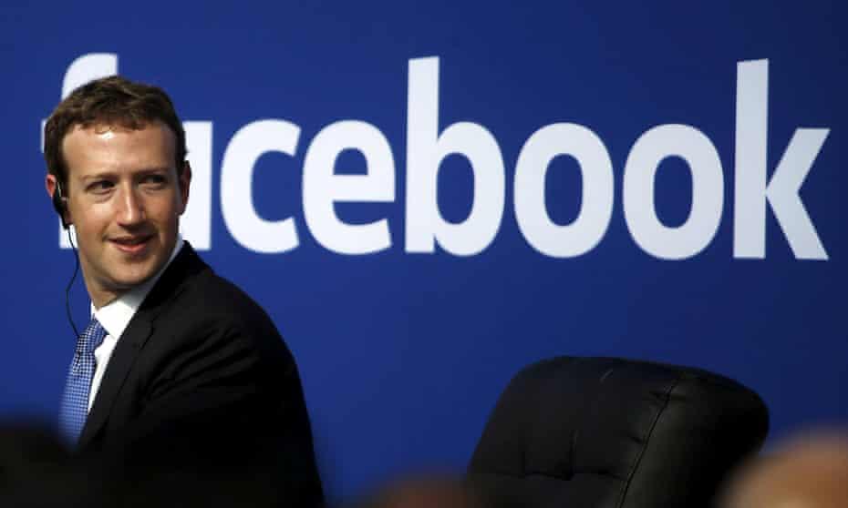 mark zuckerberg in front of a facebook logo