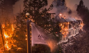 The Santa Rosa Hilton Hotel burns to the ground as the Tubbs fire sweeps through on 9 October 2017.