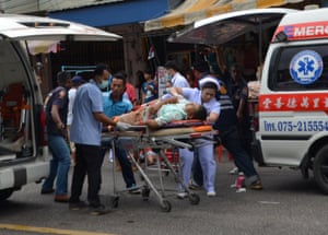 Injured people receive first aid after a bomb exploded in Trang