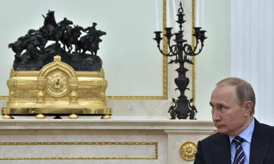 Russian President Vladimir Putin listens to Prince Albert II of Monaco at the Kremlin in Moscow, Russia, on Thursday, Oct. 6, 2016.(Yuri Kadobnov/ Pool photo via AP)