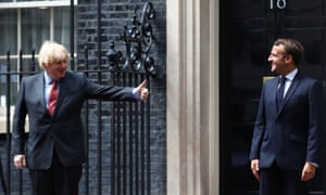 Boris Johnson (left) and Emmanuel Macron staging a socially-distanced photocall outside No 10 ahead of their talks this afternoon.