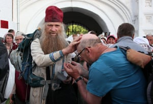 A Russian Orthodox priest blesses pilgrims