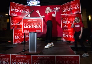 Catherine McKenna, the Liberal candidate for Ottawa Centre, arrives on stage with her daughter after being re-elected in Ottawa, Ontario
