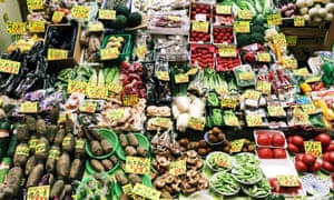 Market stall with varied vegetables at Omi-cho market in Kanazawa, Japan