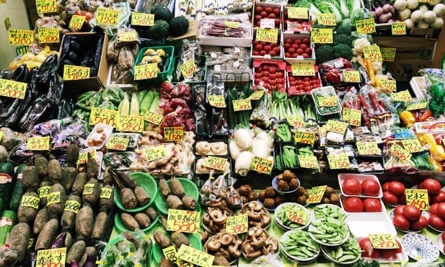 Market stall with varied vegetables at Omi-cho market in Kanazawa, Japan