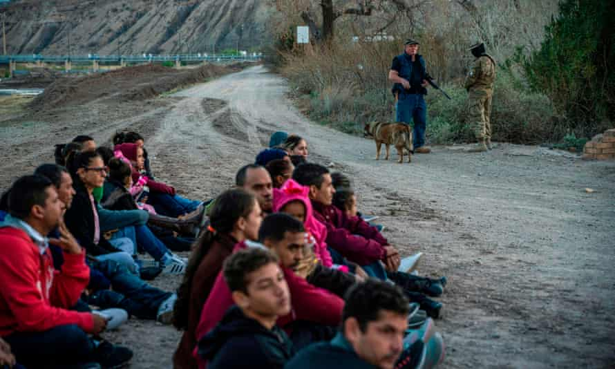 A group of migrants in Sunland Park, New Mexico, where the United Constitutional Patriots, an armed rightwing militia, patrol the US-Mexico border.