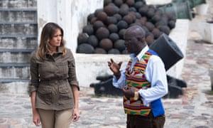 Melania Trump walks with museum educator Kwesi Essel-Blankson at the Cape Coast castle on 3 October 3.
