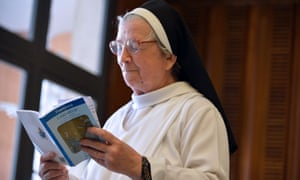 A nun reads Laudato Si'