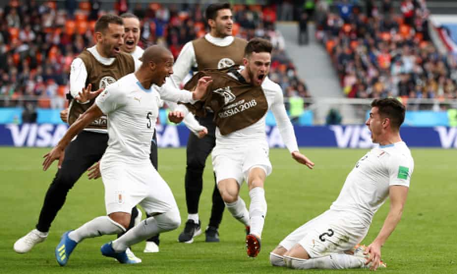 José Giménez celebrates with his teammates after securing victory for Uruguay in their opening Group A game against Egypt.