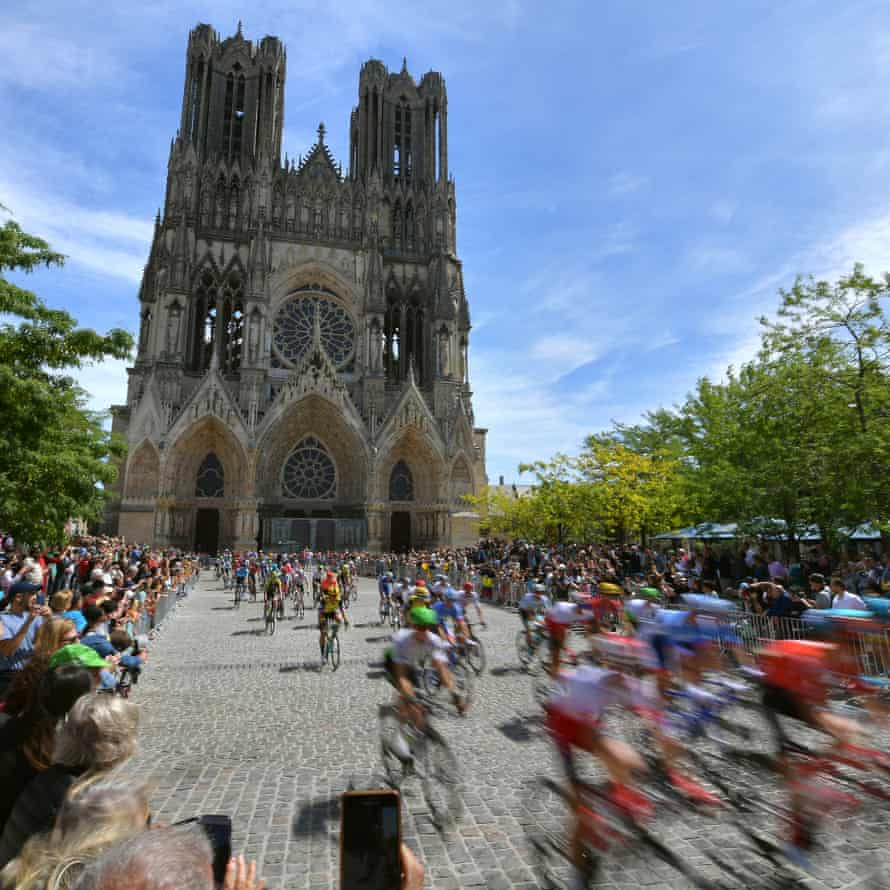 Riders are cheered as they go past the Cathedral of Our Lady of Reims at the start of Stage 4 from Reims to Nancy.