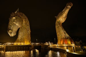 The Kelpies are lit yellow in Falkirk.