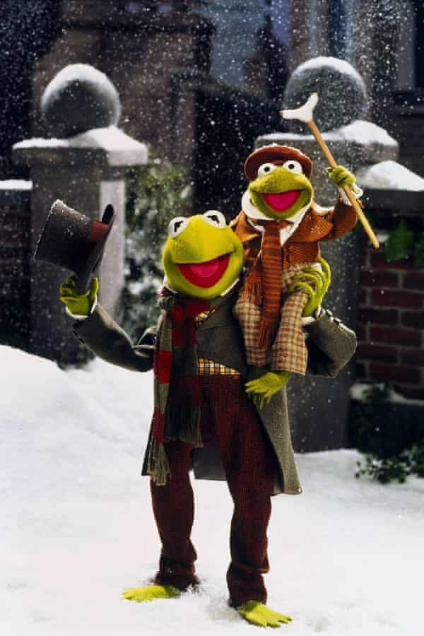 Bob Cratchit (Kermit) with Tiny Tim (Robin the Frog) in The Muppet Christmas Carol.