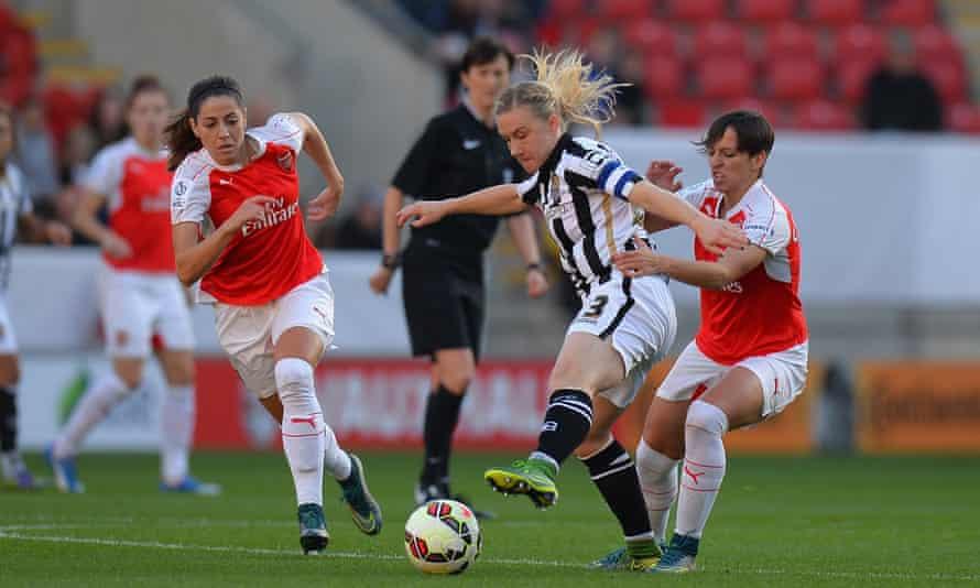 Notts County's Laura Bassett, centre, shields the ball