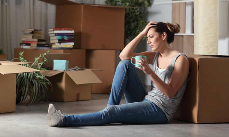 A tenant sitting among packing boxes.