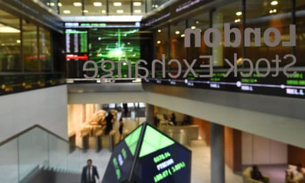 Share prices are seen on screens at the London Stock Exchange