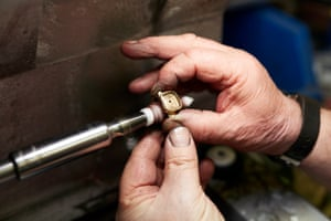 Polishing the inside of a signet ring shank.