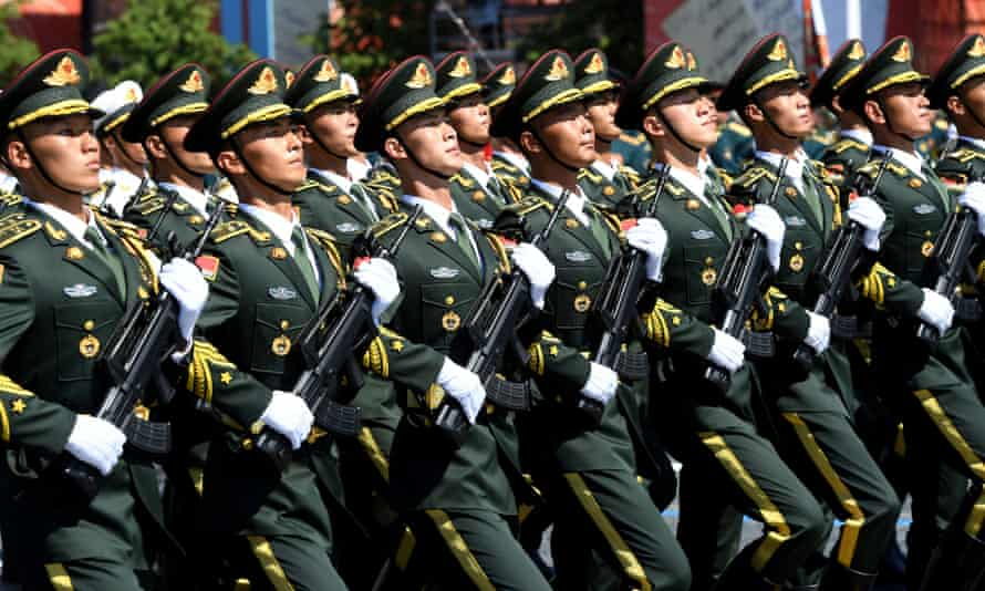 Soldiers from the People's Liberation Army join a parade in Moscow