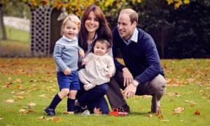 The Duchess and Duke of Cambridge, with their children George and Charlotte, in the gardens of Kensington Palace.