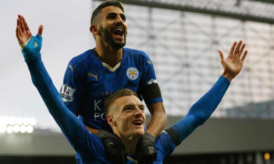 Riyad Mahrez congratulates Jamie Vardy as he celebrates scoring Leicester City's first at Newcastle United, which meant he had scored in his 10th league game in a row.