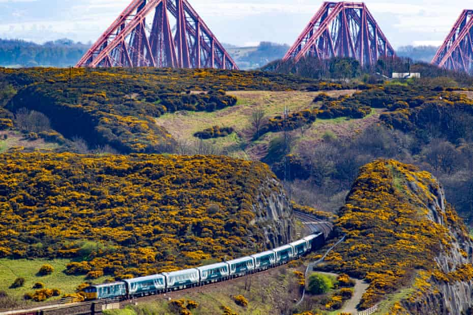 The new Caledonian Sleeper, with the Forth Rail Bridge in the background.