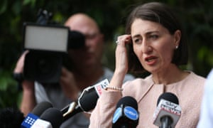 Gladys Berejiklian gestures as she speaks to the media