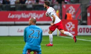 Mateusz Klich takes the ball back to the centre circle after his late equaliser for Poland.