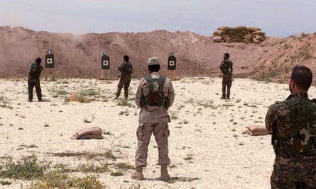 Syrian Arab trainees practice firing their small arms at an undisclosed training range in northern Syria on Saturday.