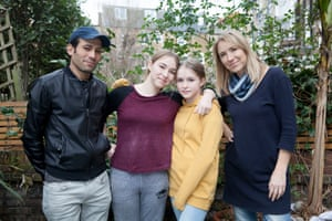 Mohammed, 34, Palestine seen in back garden with Eve, 14, Malila, 12 and host Jo