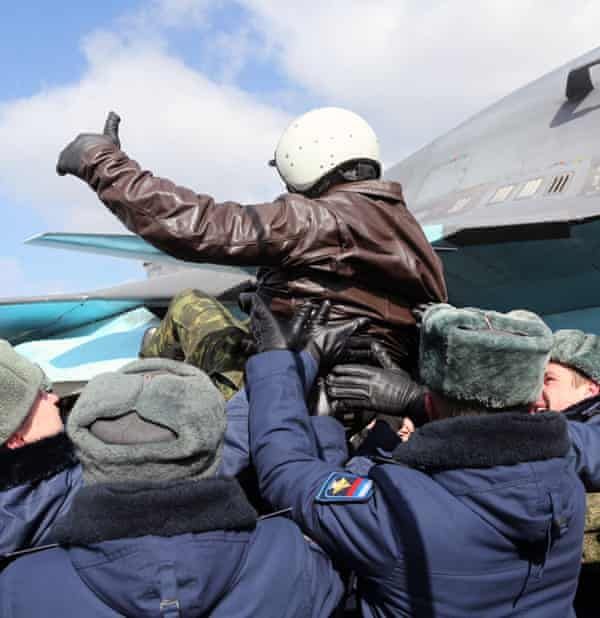 A Russian pilot returns from Syria to a hero's welcome.