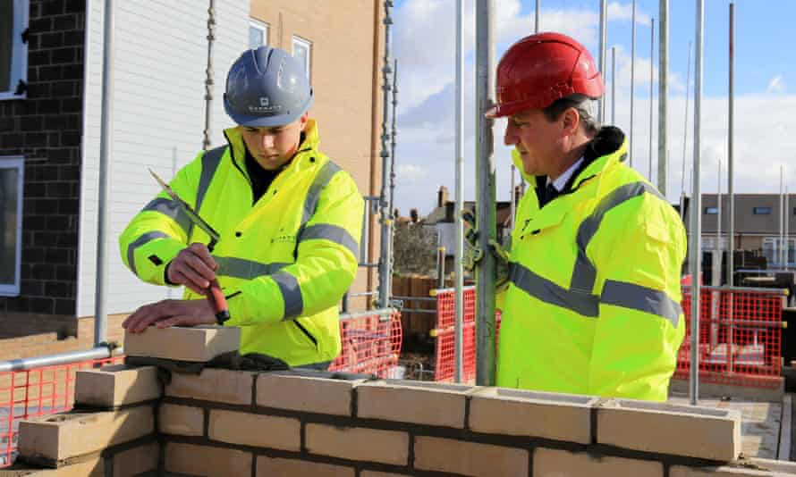 Prime minister David Cameron with a young house builder
