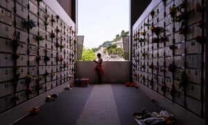 A woman at a Hong Kong columbarium during the Qingming festival, or tomb-sweeping day.
