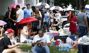 Blood donors wait in line at a blood bank in Orlando.
