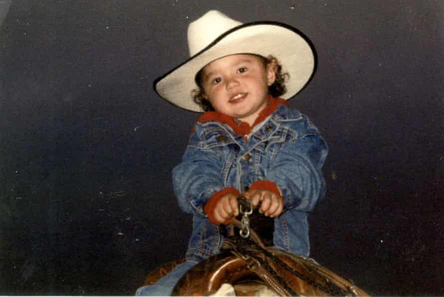 Simonson, 4 at the time, sits on her dads horse a year after learning how to ride.