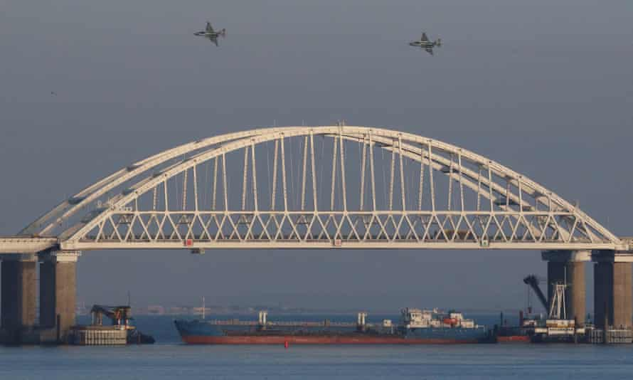 Russian jet fighters fly over a bridge connecting the Russian mainland with Crimea.