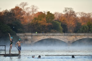 London, UK. Bathers swim in the Serpentine on a frosty morning in Hyde Park