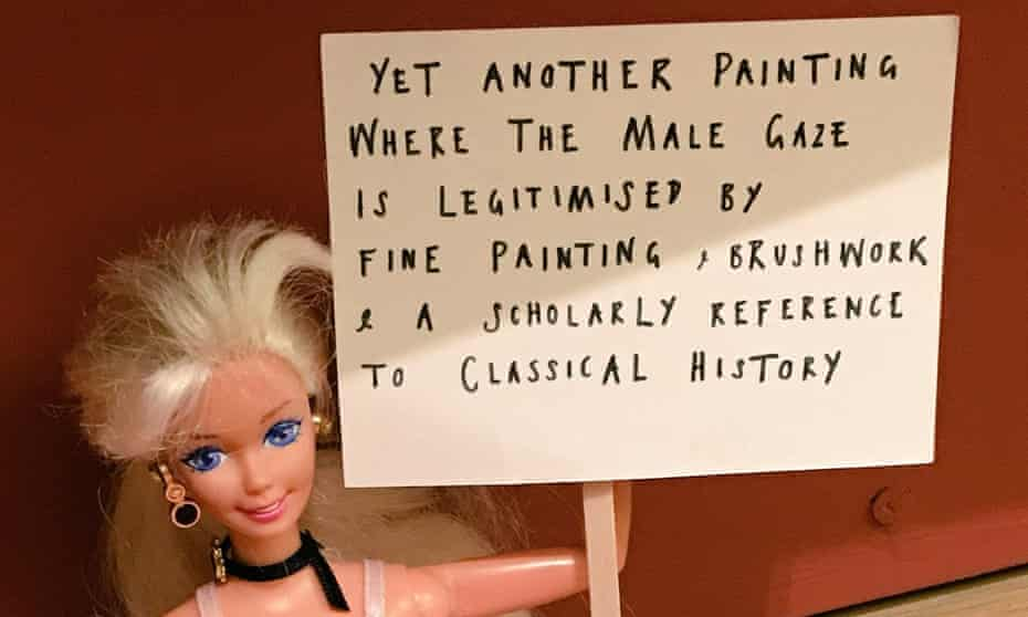 Barbie doll with protest placard at Manchester Art Gallery