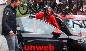 Tom Dumoulin gets into a team car after abandoning early on stage five.