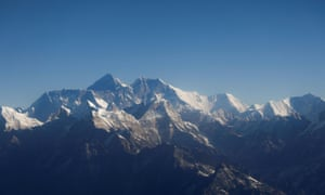 Mount Everest, the world highest peak, and other peaks of the Himalayan range are seen through an aircraft window during a mountain flight from Kathmandu, Nepal January 15, 2020.