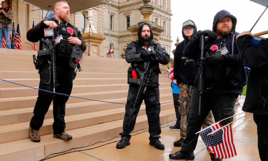 Michael Null (L) and William Null (R) at a rally to demand the reopening of businesses in Michigan, on 30 April 2020. The Nulls were charged for their alleged roles in the plot to kidnap the state governor.