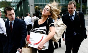 Employees walk away from the offices of Lehman Brothers