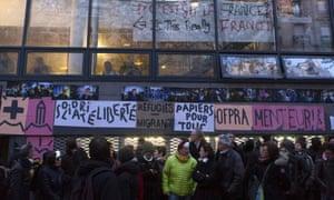 Migrants' supporters guard the Jean-Jaurès high school entrance
