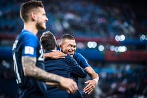 The man of the moment – and eventual young player of the tournament – Kylian Mbappé is embraced after France beat Belgium in the semi final.