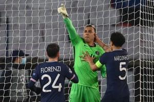 PSG's Costa Rican goalkeeper Keylor Navas celebrates after savi g Messi's spot kick.