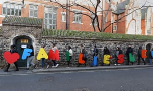 Campaigners in London, UK, last February, with a message saying Families Belong Together, relating to a call on the government to amend refugee family reunion laws