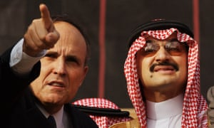 One month after the terrorist attacks on the World Trade Center, Alwaleed is escorted by then mayor Rudi Giuliani at the site of the former towers.