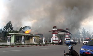 Smoke rise from a burning building after a violent rally in Wamena, Papua Province.