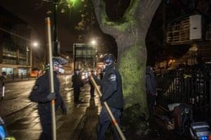 Bailiffs use a blade on a pole to cut ropes