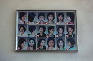 North Korean women are encouraged by the state to choose from one of the 18 officially sanctioned hairstyles, as shown in this display on the wall of a salon in the capital