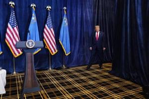 Donald Trump walks out to speak to the media at Trump International Hotel Las Vegas.